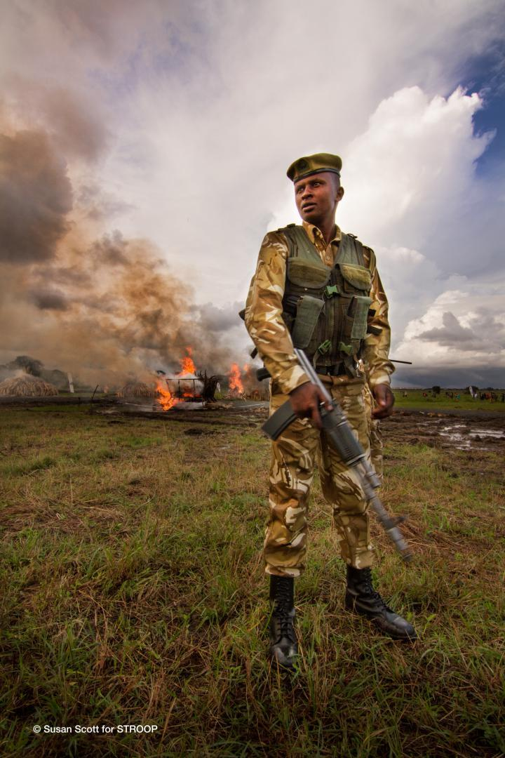 STROOP-Rhino-horn-stockpile-burn-guarded-by-Kenyan-ranger-Kenya