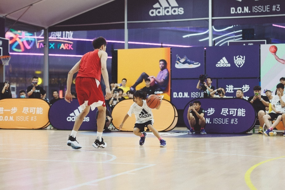 A basketball player dribbling the ball  Description automatically generated with low confidence