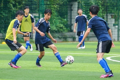 A group of boys playing football  Description automatically generated with medium confidence