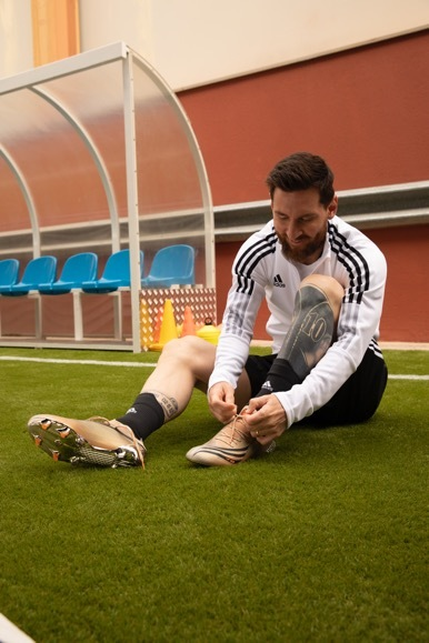 A picture containing grass, person, sport, player  Description automatically generated